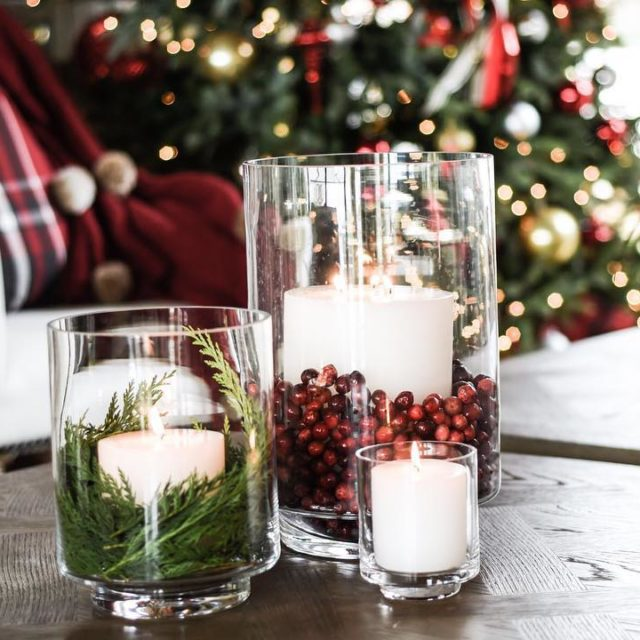 HOLIDAY DESIGN TIP Add foliage amp cranberries to glass hurricanehellip